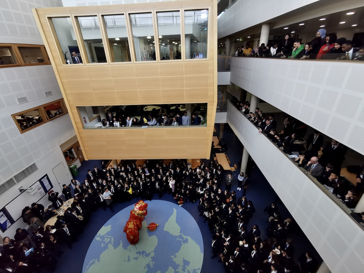 St mary magdalene academy smma islington london the entire school lines the halls to watch a lion dance for chinese new year 2020