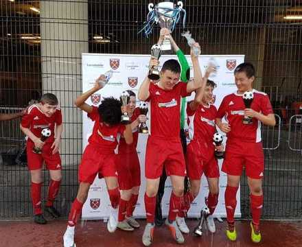 St mary magdalene academy islington year 9 boys football cup win 3 trophies in 2019 and are voted best under 14s sports team in the islington sports awards