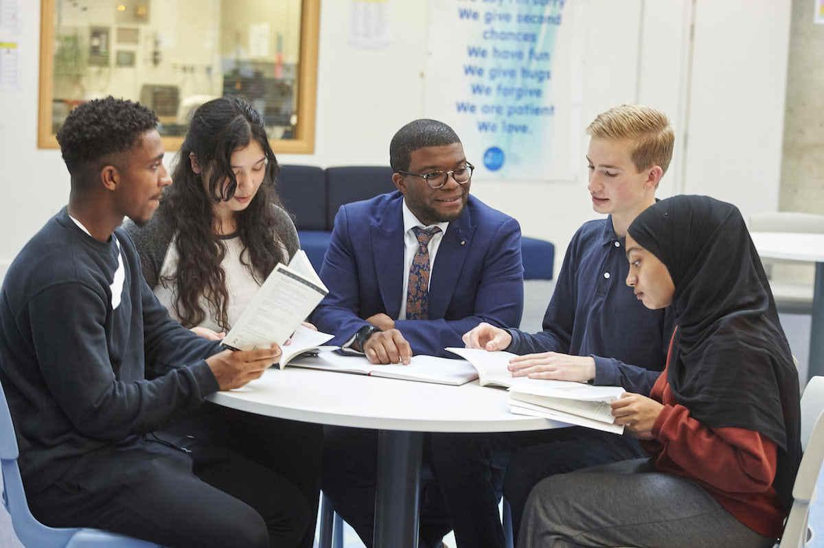 Islington sixth form students from st mary magdalene academy london chatting with deputy headteacher dami ajagbonna